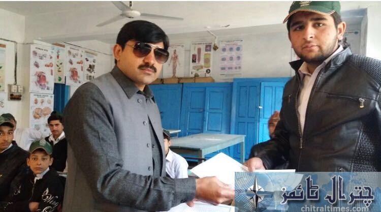 ac chitral sajid nawaz distributing domicile in Drosh school