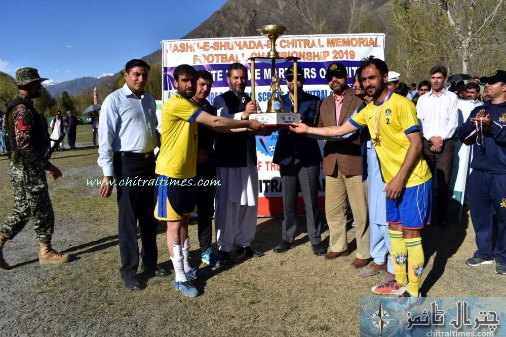 shohada memoral footbal tournamnet chitral final winner danin team receiving trophy