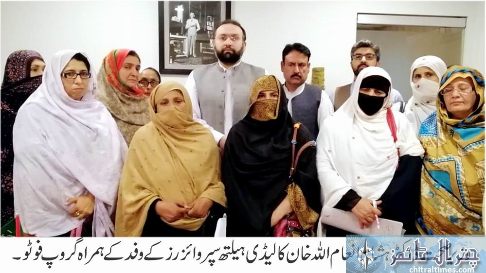 Minister Health group photo with lady health supervisor